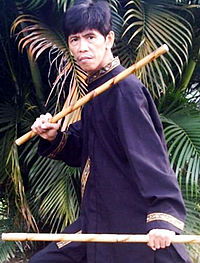Not Paul George, but another person posing with rattan sticks